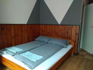 Łóżko lub łóżka w pokoju w obiekcie Pensjonat Syriusz