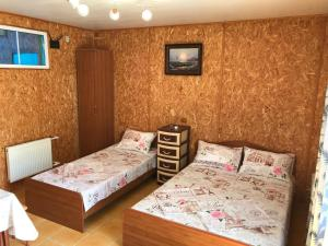 A bed or beds in a room at Private House Avacha