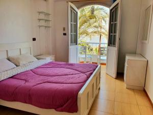 Ein Bett oder Betten in einem Zimmer der Unterkunft Luxor Guest House