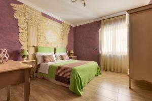 Letto o letti in una camera di Hestasja Exclusive Rooms & Breakfast