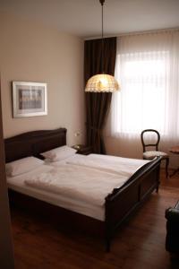 Un ou plusieurs lits dans un hébergement de l'établissement Pension Post Rüdesheim