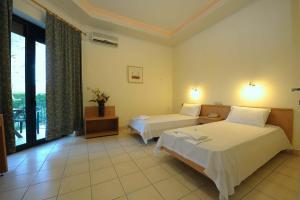 Ένα ή περισσότερα κρεβάτια σε δωμάτιο στο Kentrikon Hotel & Spa