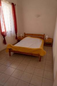 Un ou plusieurs lits dans un hébergement de l'établissement Gîte La Place