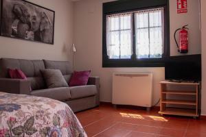 Zona de estar de Apartamentos Luarca