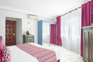 Un ou plusieurs lits dans un hébergement de l'établissement La Frégate