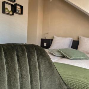 A bed or beds in a room at B&B Mol