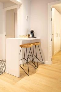 A kitchen or kitchenette at Barcelona Touch Apartments