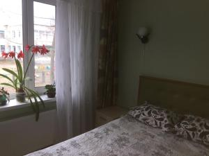 Кровать или кровати в номере Apartment on Lenina Street
