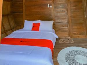 A bed or beds in a room at RedDoorz Resort @ Cianjur City Park