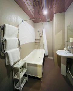 Ванная комната в Guest House Four Rooms