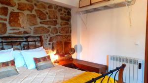 En eller flere senge i et værelse på Casa da Lomba