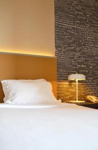 Кровать или кровати в номере Hotel Do Colegio