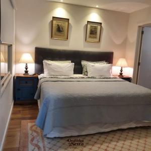 A bed or beds in a room at Pousada Orquidea da Serra