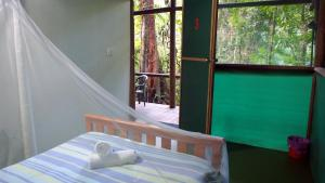 A bed or beds in a room at Daintree Crocodylus