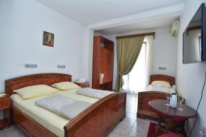 Кровать или кровати в номере Hotel Grbalj