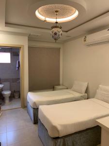 Cama ou camas em um quarto em Bab Alhijra Aparthotel