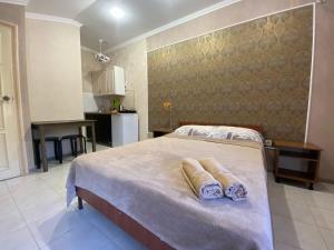 Кровать или кровати в номере Zemfira