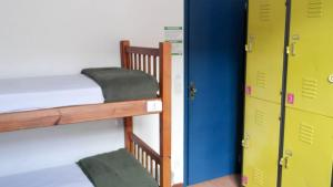 A bunk bed or bunk beds in a room at POA Eco Hostel