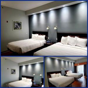 A bed or beds in a room at Blue Bay Inn and Suites