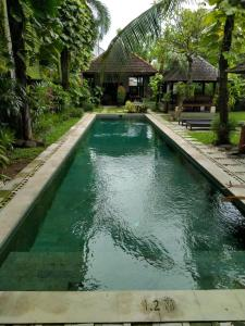 The swimming pool at or close to Ganga Hotel & Apartment