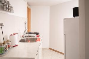 Cucina o angolo cottura di הוילה ברחוב הנץ
