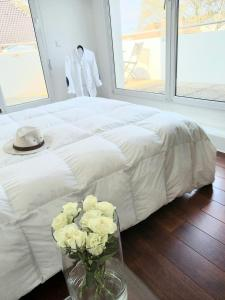 A bed or beds in a room at Bel appartement