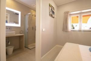 A bathroom at Villa Bellevue - 3