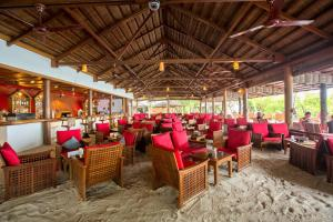 A restaurant or other place to eat at Reethi Beach Resort