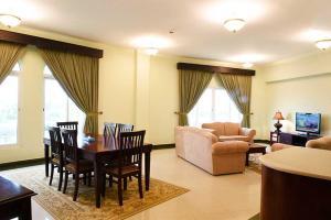 A seating area at Karan Hotel