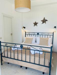 Letto o letti in una camera di Viestemare Resort & SPA
