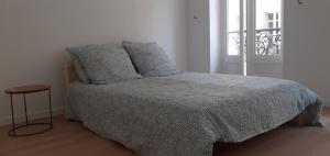 A bed or beds in a room at refuge urbain