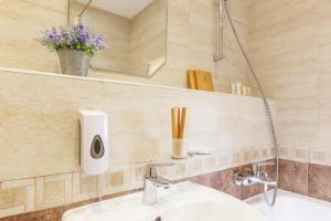 Ванная комната в Апартаменты у моря