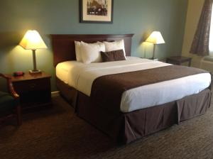 A bed or beds in a room at The Texas Lodge
