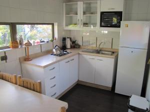 Una cocina o zona de cocina en Cabañas Ecobox Andino