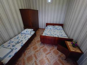 A bed or beds in a room at Гостевой дом Дача