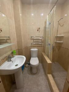 Ванная комната в Гостевой дом Орхидея