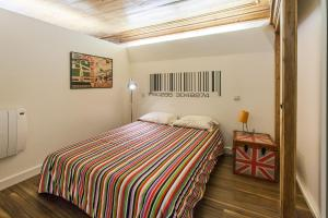 A bed or beds in a room at Go2Oporto - Historical Center