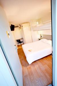A bed or beds in a room at Premiere Classe Marseille Vitrolles Anjoly
