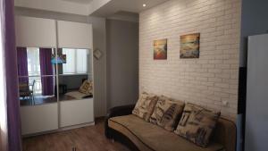 Гостиная зона в Апартаменты App Star