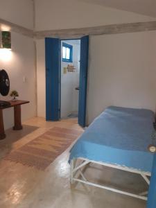 Cama ou camas em um quarto em Pousada Casa da Praia Itaúnas