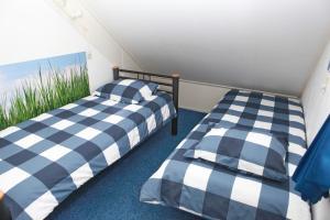 Een bed of bedden in een kamer bij Teska Bed & Breakfast