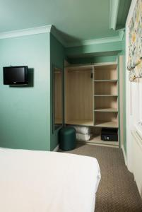 A television and/or entertainment center at Caring Hotel