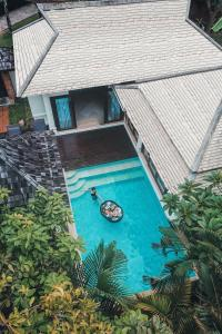 A view of the pool at Melati Beach Resort & Spa - SHA Plus Certified or nearby