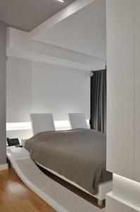 A bed or beds in a room at Suite Testani