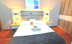 Cama o camas de una habitación en Hotel Nueva Plaza