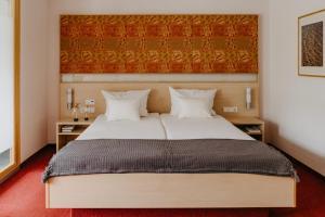 Кровать или кровати в номере Ringhotel Johanniterbad