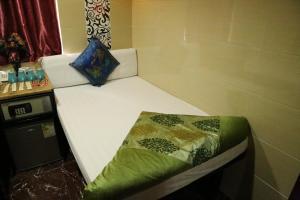 Ein Bett oder Betten in einem Zimmer der Unterkunft New Tokyo Hostel