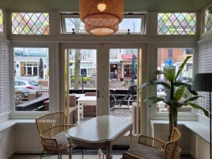 Restaurant ou autre lieu de restauration dans l'établissement Loren & Fellini