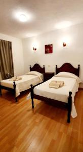 A bed or beds in a room at Villa Belinha - Guest House
