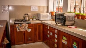 A kitchen or kitchenette at Inka's Rest Hostel